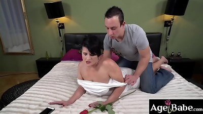 Lusty granny Dolly Bee is teased by Rob and his rose