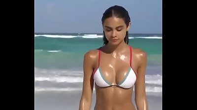 hot magnificent sweat-soaked woman on beach